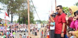Bupati Bintan H. Apri Sujadi, S.Sos didampingi Ketua TP PKK Kabupaten Bintan Hj Deby Apri Sujadi.