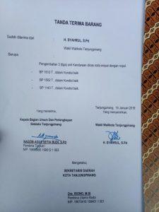 Salinan surat tanda terima mobil dinas
