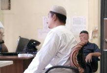 . Pasaribu dan Muslim Matondang saat buat laporan di ruang unit Pidum Sat Reskrim Polres Tanjungpinag